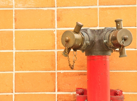 Old red fire hydrant on wall of Thailand photo