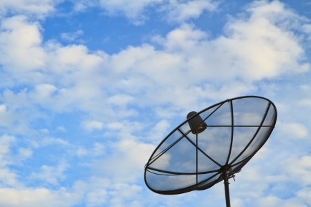 Satellite dish on sky background photo