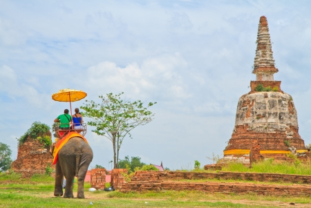 pagoda in thai the  temple  and  tourist sit elephant photo