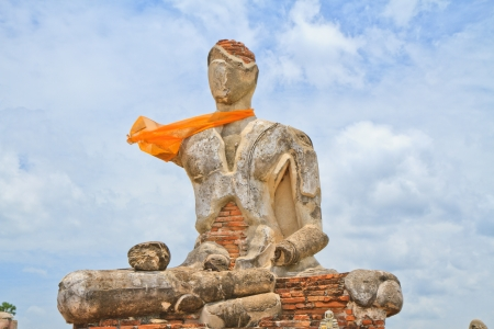 Buddha image , ruins ,on blue sky background photo