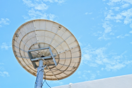 Satellite dish with sky on roof Stock Photo - 15814527