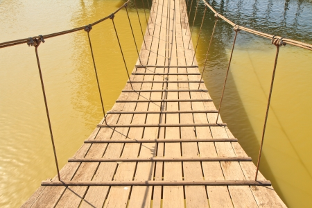 The rope bridge on water photo
