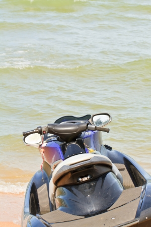 Jet ski on the beach looking at the sea photo