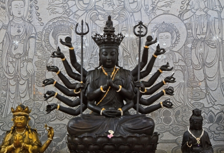 Black goddess and Buddha on wall background photo