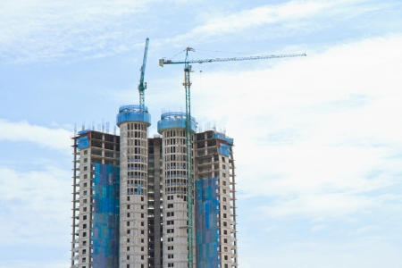 High rise building under construction on blue sky background