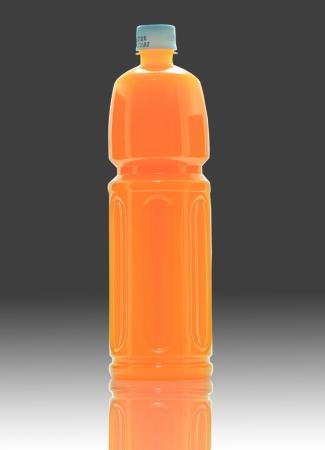 bottles of juice on a black background photo