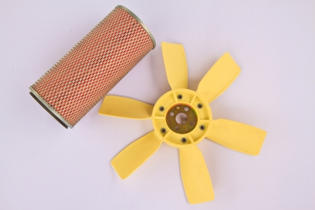 lubricate: Car filter and a fan using for cooling in engines on white background