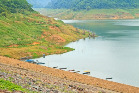 compacted: Khundanprakanchon dam,Compacted concrete dam in Thailand,Water in dam and boats