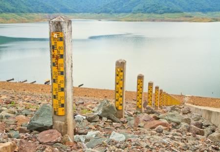 depth measurement: water meter  Meter used to measure the level of water in dam Stock Photo