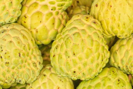 Sugar Apple group for sale on table in market photo