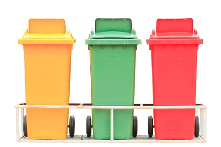 Yellow red and green garbage bin with wheels isolated on white background photo