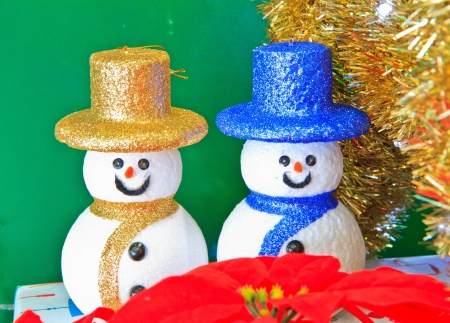 cute snowmans on green background photo