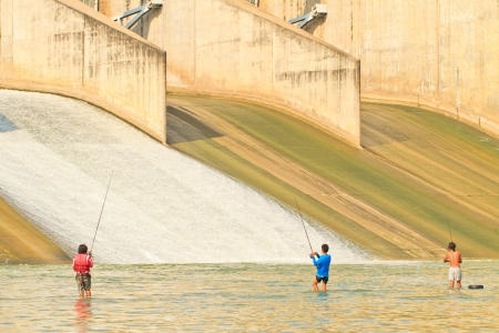 A view of a fishermans fishing on a PASAK Dam background, Thailand Stock Photo - 16943746