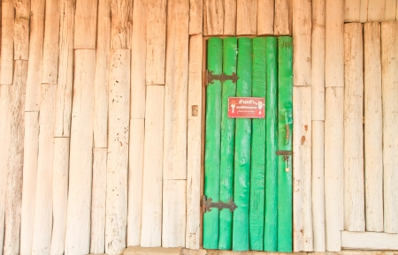 old white wood wall and green door, You can use background Stock Photo - 17021348
