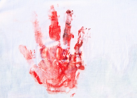 Close up of red hand painted on white T-shirt  background Stock Photo - 17272039