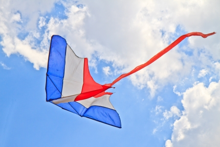 flying kite in the air against the blue sky Stock Photo