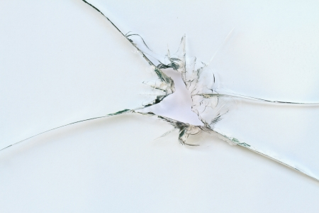 Broken window on white background photo