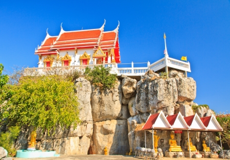 Buddhist temple on mountain, Blue sky background photo