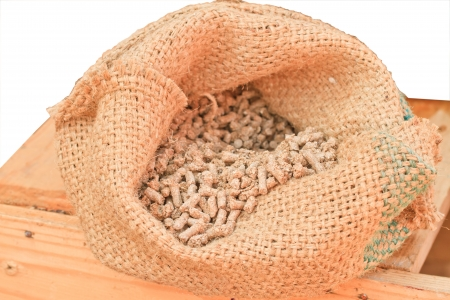 pullet: The feed pullet in bag on wood table  Stock Photo