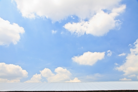Metal sheet roof on blue sky background Stock Photo
