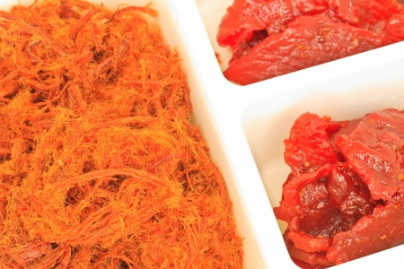 Close up dried shredded pork on white background photo