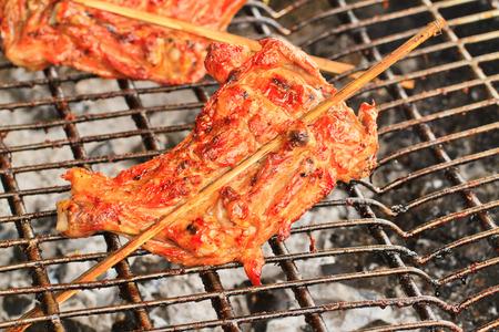 brazier: Close up roasting chicken on brazier Stock Photo