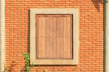 Old wood window and brick wall background