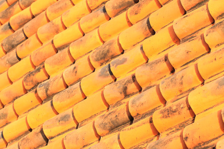 Yellow roof tiles of a old built house 스톡 콘텐츠
