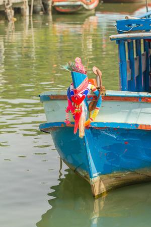 festoon: Old head wooden fishing boat and festoon on sea