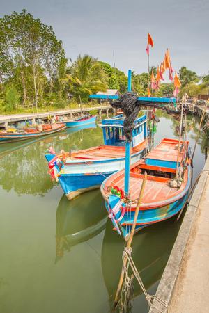 festoon: Old wooden fishing boat and festoon on sea