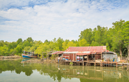 Galvanized iron roof, wooden old hut, Boat seaside and trees
