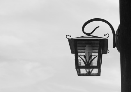 Old wall lamp is black and white on white background