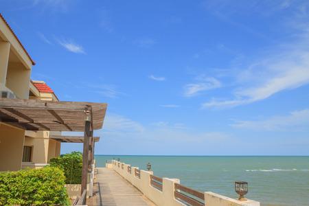 Hotel near beach and sea on blue sky background