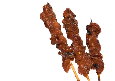 Skewers of chicken on white background Stock Photo