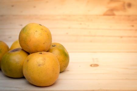 tangerine orange on wood