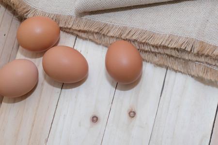 Egg on a burlap sack Фото со стока