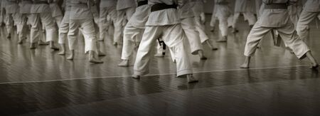 Kidss training on karate-do. Banner with space for text. For web pages or advertising printing. Photo without faces. Banco de Imagens
