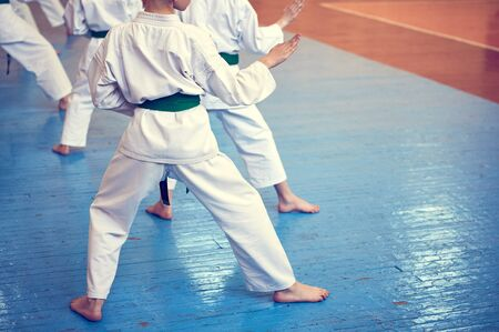Kids training on karate-do. Banner with space for text. Retro style. For web pages or advertising printing. Photo without faces.