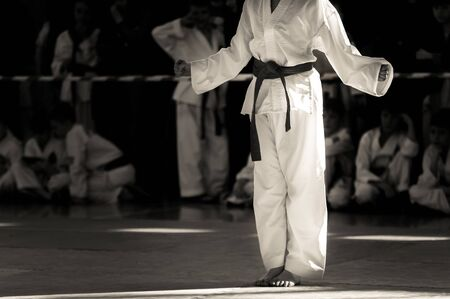 Taekwondo martial art. An athlete in a white kimono, without a face, is preparing for an indicative performance. Stok Fotoğraf