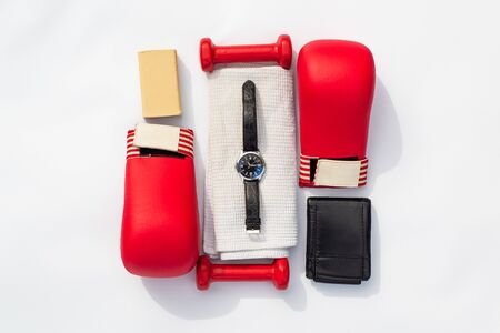 Brutal men's fitness. men's sports equipment for martial arts. Rad gloves,  dumbbells, towel and watch on a white background. Archivio Fotografico