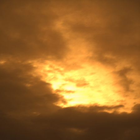 Fantastic sky with bright sun. Orange color background Фото со стока