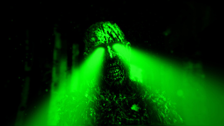 Dark zombie with green rays from the eyes in dungeon. Horror character concept. Green background color.