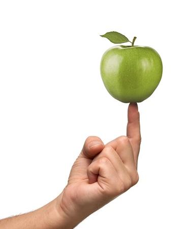 poise: Apple on finger