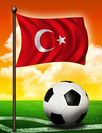 Turkish flag and ball on soccer field photo