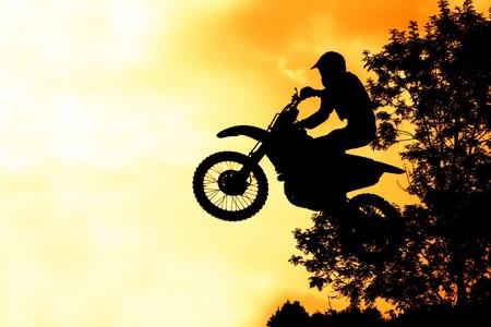 mx: MX rider silhouette on fire sky