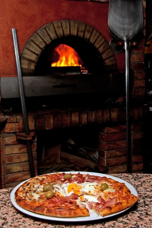 fire bricks: Ready-made pizza waiting in front of the oven