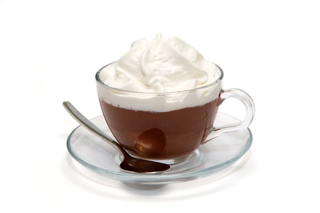 Hot chocolate with cream in glass cup
