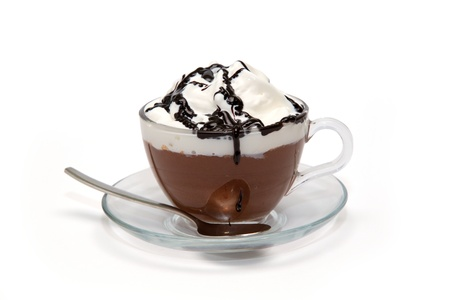 Hot chocolate with cream and syrup in glass cup photo