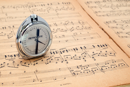 Pocket metronome  on an ancient music score author of notes A Scriabin 1872-1915, Op 20 concert for the piano accompanied by second piano by N  Gilaiew, Moscow 1931  Stock Photo - 27712100