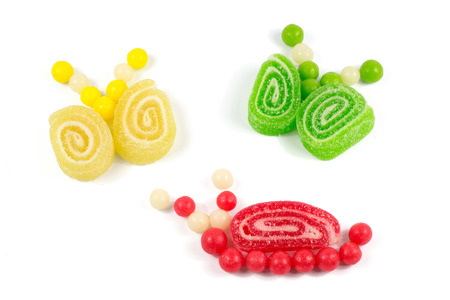 Snail and butterflies made of colorful bonbons and  jelly  photo